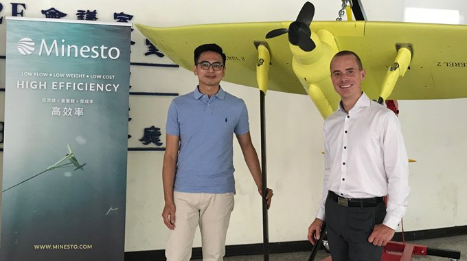 Minesto's Yung-Lung Chen and Sven Granfors next to a prototype of Minesto's Deep Green marine energy technology