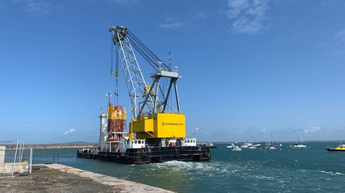 The MGS buoy being lifted off the quay in Holyhead before being towed to site. Photo: Louise Marsden